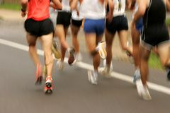 Runners. Legs on the road with panning blur Royalty Free Stock Images