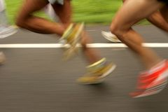 Runners. Legs on the road with panning blur Stock Images