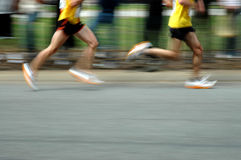Runners. Two runners with motion blur and room for copy Royalty Free Stock Image