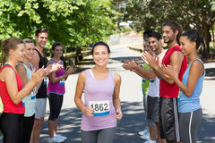 Runners applauding a racer in the park Royalty Free Stock Photos