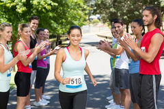Runners applauding a racer in the park Stock Image