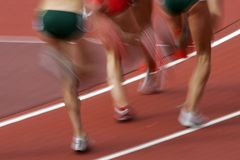 Runners blur 03. Blurred runners move along the track Royalty Free Stock Image