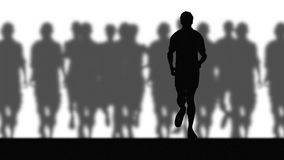 Runners (blurred background) Royalty Free Stock Image