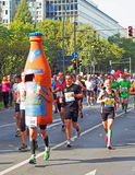 Runners and a bottle at Berlin Marathon 2014 Royalty Free Stock Photography