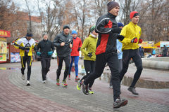 Runners in the city jogging center of dnepropetrovsk at a distance of km december dnepropetrovsk ukraine Royalty Free Stock Photography