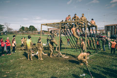 Runners climbing structure in a test of extreme obstacle race Stock Photo