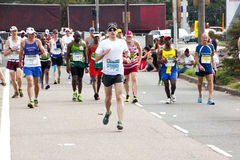 Runners competing in 2014 Comrades Marathon Road Race Royalty Free Stock Photography