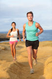 Runners couple jogging for fitness running outside Royalty Free Stock Images