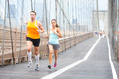 Runners couple running in New York Stock Photography