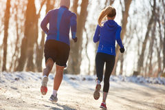 Runners couple running in park Stock Photography