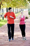 Runners couple sport. Runners couple running on trail in cross country run outdoors training on jogging track, Fit young fitness model men and asian women royalty free stock photo