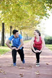 Runners couple sport. Runners couple running on trail in cross country run outdoors training on jogging track, Fit young fitness model men and asian women stock photo