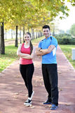 Runners couple sport. Runners couple running on trail in cross country run outdoors training on jogging track, Fit young fitness model men and asian women stock photography