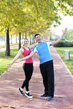 Runners couple sport. Runners couple running on trail in cross country run outdoors training on jogging track, Fit young fitness model men and asian women royalty free stock images