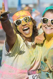 Runners Covered In Colored Corn Starch Celebrate Finishing Color Run Royalty Free Stock Photography