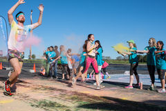 Runners Are Covered With Colored Corn Starch At Color Run Royalty Free Stock Photo