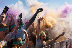 Runners Create Color Explosion With Packets Of Colored Corn Starch Royalty Free Stock Photo