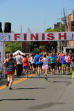 Runners crossing the finish line, July 4th race, downtown Saratoga, New York,2016 Stock Photo