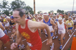Runners crossing the starting line Royalty Free Stock Image
