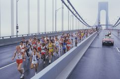 Runners crossing Verrazano Bridge. View of runners crossing Verrazano Bridge at the start of NY City Marathon stock images