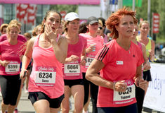 Runners dressed in pink Royalty Free Stock Photos
