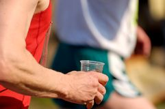 Runners drink. A lot of runners at the berlin half marathon Stock Photo