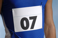 Runners Entry Number. Marathon runners entry number on blue shirt Royalty Free Stock Photography