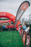Runners in a extreme obstacle race on start line ready to run Royalty Free Stock Photo