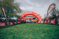 Runners in a extreme obstacle race on start line ready to run Stock Photography