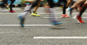Runners feet on the road in blur motion Royalty Free Stock Photo