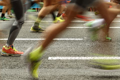 Runners feet on the road in blur motion Stock Image