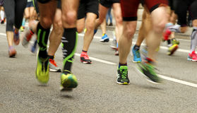 Runners feet on the road in blur motion Royalty Free Stock Image