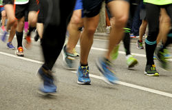 Runners feet on the road in blur motion Royalty Free Stock Images