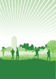 Runners in a field. On a cityscape background Royalty Free Stock Photo