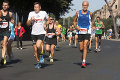 Runners foreground and several runners in background Royalty Free Stock Photography