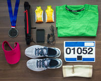 Runners Gear And Energy Gels On Wood Background Stock Images