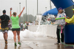 Runners Get Soaked By Squirt Guns At Race Finish Line Royalty Free Stock Photos