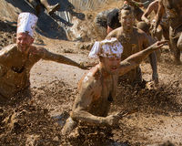 Runners going through the mud Stock Image