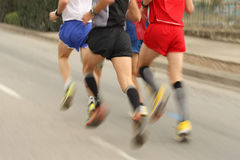 Runners group. Runners legs on the road with panning blur Stock Images