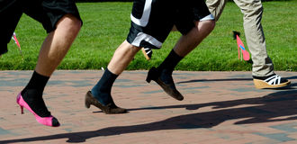 Runners on heels during charity run Royalty Free Stock Images