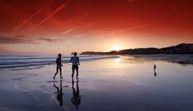 Runners in Hendaye beach Royalty Free Stock Image
