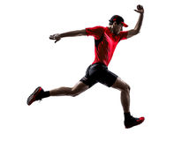 Runners joggers running jogging jumping silhouettes. One young man runners joggers running jogging jumping in silhouettes isolated on white background Royalty Free Stock Photos