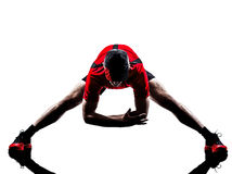 Runners joggers stretching warming up silhouettes Royalty Free Stock Photos