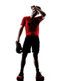 Runners joggers tired exhaustion breathless heat silhouettes. One young man runners joggers tired exhaustion breathless heat in silhouettes isolated on white Royalty Free Stock Photos