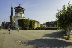 Runners jogging past the Maritime Museum tower along a cobbled path in Dusseldorf, Germany. Runners jogging past the Maritime Museum tower along a cobbled path stock photos