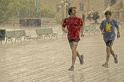 Runners Jogging in Rain in Quebec City Royalty Free Stock Photos