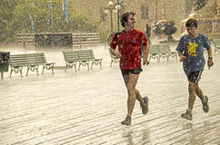 Runners Jogging in Rain in Quebec City Royalty Free Stock Photo