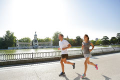 Runners jogging running in Madrid El Retiro park Stock Photos