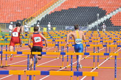 Runners on the lanes with barriers Stock Image
