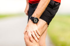 Runners leg knee pain injury Royalty Free Stock Image